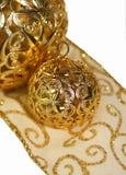 Holiday ornaments and ribbon. Holiday ornaments on ribbon, isolated Stock Photography