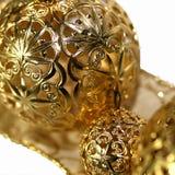 Holiday ornaments and ribbon. Isolated Stock Photos