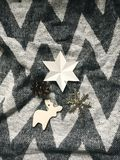 Holiday ornaments, stylish christmas reindeer ,star,snowflake to. Y on rustic blanket. Top view. Atmospheric cozy image, warm winter mood. Mobile Photo royalty free stock images