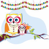 Holiday owls on a branch Royalty Free Stock Photography