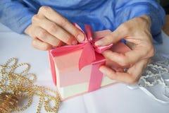Women`s hand made gift box. Holiday package handmade. Stock Photo