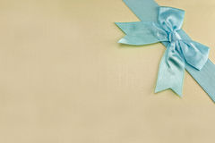 Holiday packages. Holiday package with a blue ribbon and a bow Stock Image