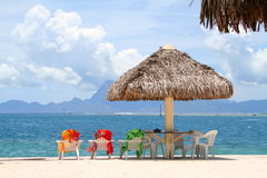 Holiday in paradise. Three colorful chairs aligned on a beach in Tahiti, French Polynesia royalty free stock image