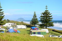 Holiday park – an absolute beachfront, beautiful seascape and bright blue ocean. royalty free stock image