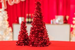 Holiday Party in red and white themed decor, red tinsel tree in focus stock images