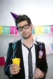 Holiday party young man funny glasses. Suit open handkerchief Stock Photo