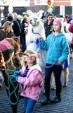 Holiday pet parade in Michigan. December 5, 2015: children walk with alpacas in the holiday pet parade in St Joseph Michigan royalty free stock photo