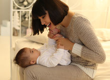 Holiday photo.beautiful mother posing with her cute little baby. Stock Photos