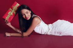 Holiday photo. beautiful woman in elegant dress with Christmas presents Royalty Free Stock Image