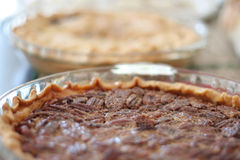 Holiday Pies. Close up of a pecan and apple pie with limited depth of field Royalty Free Stock Photo