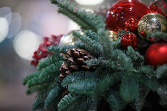 Holiday pine branch with cone. Decorations on blurred background Royalty Free Stock Photo