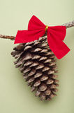 Holiday Pinecone with a Red Bow Stock Photography