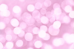 Holiday pink background with blurred lights Royalty Free Stock Images