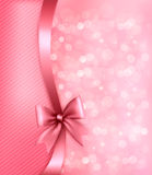 Holiday pink background with gift bow and ribbon. Royalty Free Stock Photos