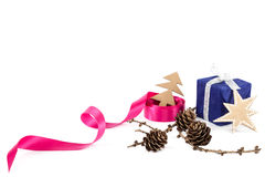 Holiday pink ribbon and a branch of pine tree with cones Royalty Free Stock Images