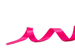 Holiday pink ribbon on white background. Stock Photography
