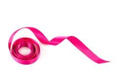 Holiday pink ribbon on white background. Stock Image