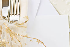 Holiday place setting with blank card. Beautiful holiday place setting. Blank card included stock photo