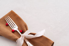 Holiday Place Setting on White Tablecloth Royalty Free Stock Photos