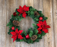 Holiday Poinsettia Christmas wreath on rustic wooden boards Stock Photos