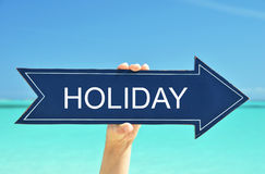 Holiday pointer. In the hand Royalty Free Stock Photography