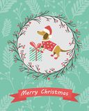 Holiday postcard with funny dachshund and gift Stock Photos