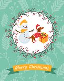 Holiday postcard with funny dachshund and snowman Stock Photo
