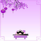 Holiday postcard to Chinese New Year. Greeting postcard to Chinese New Year. Branch of sakura with sky lanterns and table with sushi rolls and sticks on violet Stock Photography