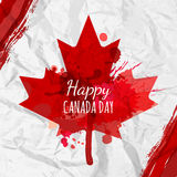 Holiday poster with red Canada maple leaf drawn on crumpled white paper. Royalty Free Stock Photo