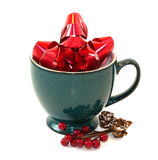Holiday Pottery Coffee Cup. Green pottery coffee cup filled with holiday decorations stock photos