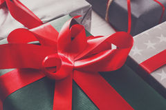 Holiday present boxes closeup on white wood background Stock Image