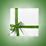 Holiday Present White Box with green Ribbon on a gradient background Royalty Free Stock Photos