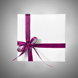 Holiday Present White Box with Purple Pink Ribbon on a gradient background. Holiday Present White Box with Purple Pink Ribbon Royalty Free Stock Photography