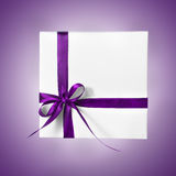 Holiday Present White Box with Purple Pink Ribbon on a gradient background. Holiday Present White Box with Purple Pink Ribbon Stock Images