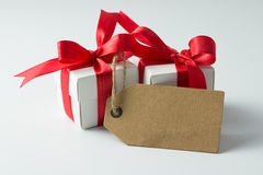 Holiday presents with empty tag Royalty Free Stock Photography