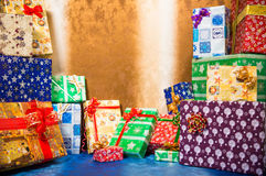 Holiday presents. Multicolor packed holiday presents at colorful background Stock Photography