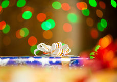 Holiday presents ribbon at abstract background. Colorful gift boxe with ribbons at abstract colorful lights background Stock Photo