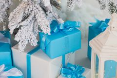 Holiday presents in white and blue wrapping paper under Christma Royalty Free Stock Photos