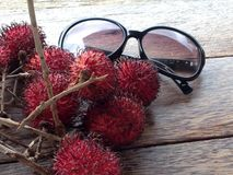 Holiday with Rambutan In Ubud Bail. This photo is taken in Ubud Bali with Rambutan and glasses to depict ultimate holiday Royalty Free Stock Images