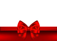 Holiday red background with gift bow and ribbon Stock Photo