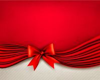 Holiday red background with gift glossy bow and ri Royalty Free Stock Photography