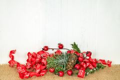 Holiday red berry and pine with ribbon stock photography