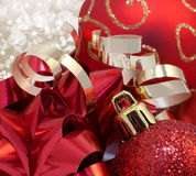 Holiday Red and Gold Decorations Close Up. Red holiday ornaments and gold accents close up Royalty Free Stock Images