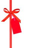 Holiday red ribbon with tag Stock Images