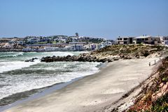 Holiday Resort Beach. Beach with a holiday resort in the background Stock Images
