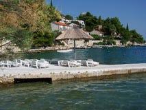 Holiday resort in Croatia. Wild rocky beach full of pine trees in Croatia Royalty Free Stock Photography