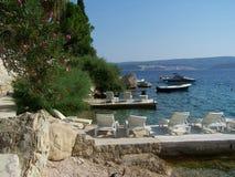 Holiday resort in Croatia. Wild rocky beach full of pine trees in Croatia Stock Photography