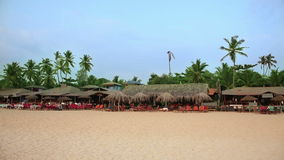 Holiday resort on sandy beach. Idyllic holiday resort on sandy beach stock footage