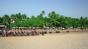 Holiday resort on sandy beach. Idyllic holiday resort on sandy beach by the sea stock footage