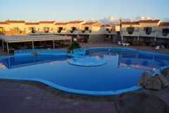 Holiday Resort Swimming Pool at Sunrise Royalty Free Stock Images